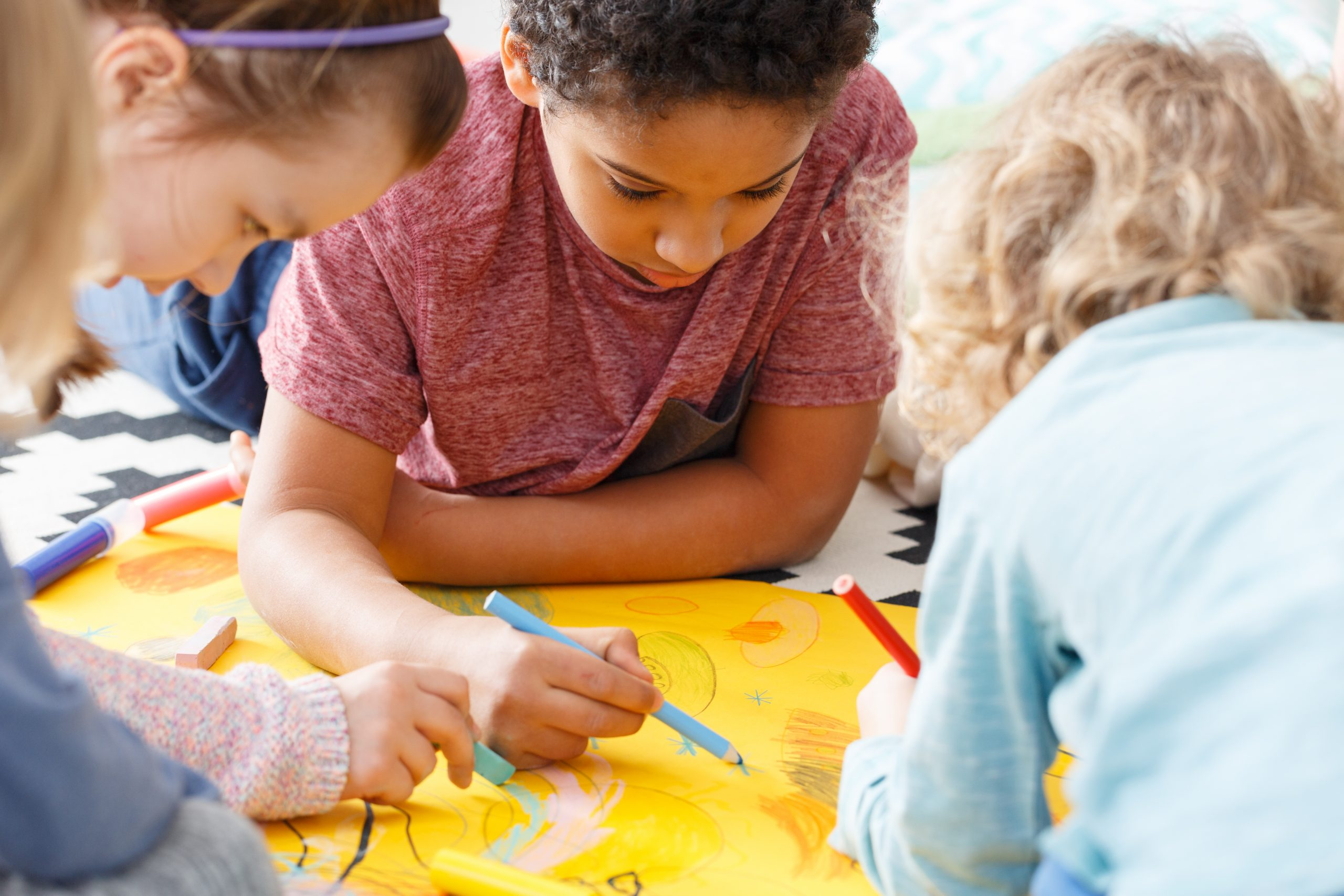 Young children having fun during art lesson in school
